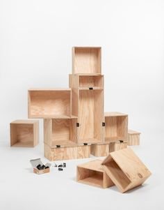 """With the container system """"1530"""" you can create a variety of diverse structures, from a room partitioning to a coffee table – all is possible. The simple container elements made from French sea pine plywood are based on a grid of 15 and 30 centimetres - Designer: Daniel Gafner"""