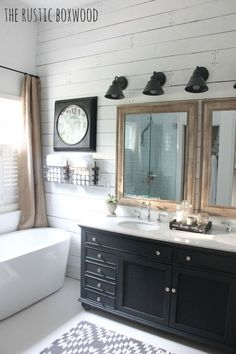 Our DIY, Farmhouse-Styled Master Bathroom Renovation - Also, what do you think about these sconces? They're actually outdoor lanterns, but who says you can't bring them inside?! And at $30 each, you can't beat that price!