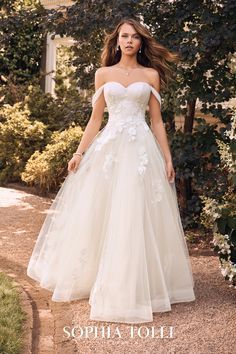 Sophia Tolli | Whimsical Boho Floral-Inspired Ballgown. Float down the aisle and straight into your happily ever after in this soft and whimsical ballgown! With a classic sweetheart neckline and delicate off-the-shoulder straps, the bodice features layers of finely ruched tulle under floral-inspired cotton lace. Available in sizes 0-32 and colors Ivory/French Beige, Black/French Beige, Ivory, Black/Ivory, White. Stunning Wedding Dresses, Wedding Gowns, Boho Wedding, Dream Wedding, Wedding Bubbles, Gowns With Sleeves, Bridal Looks, Bridal Collection, Bridal Dresses