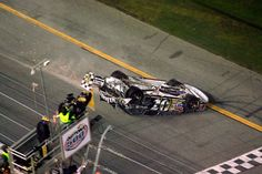 Clint Bowyer on his roof, crossing the Daytona 500 finish line, in the 2007 race.
