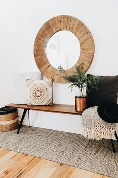 oversize round wood mirror with a midcentury modern style bench and cozy pillows and throws to add warmth(Mix Wood Living Room) Round Wood Mirror, Circular Mirror, Round Mirrors, Decor Interior Design, Interior Decorating, Decorating Ideas, Eclectic Design, Interior Designing, Room Interior