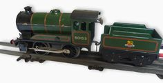 Hornby tinplate 'O' gauge 0-4-0 locomotive with tender, 50153, first and third class coaches and passenger brake van (tender, coaches and brake van in original boxes, No.51) Estimate £250.00 to £350.00 (Lot no: 370 in sale on 21/10/2014 - The Cotswold Auction Company)