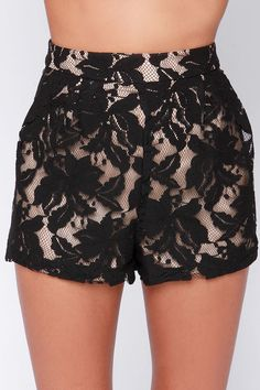 """It's about time you got something nice to spoil yourself, and what better splurge than the A Lace for Everything Black Lace Shorts! Sheer black lace plays out in an appealing floral display over the beige lining of these high-waisted shorts with subtle pleats emerging from the fitted waistline. Hidden side zipper. Fully lined. Model is 5'9"""" and wearing a size small. Self: 51.4% Cotton, 25.3% Rayon, 23.3% Nylon. Lining: 100% Polyester. Dry Clean Only."""