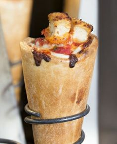 Forget about flat pizza slices. Kono's pizza comes rolled up in a cone!