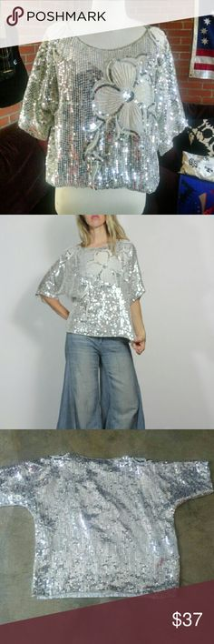 """Vintage Silver Sequined Silk Boho Top Glitzy shimmery silver drapey sequin top Mini pearl detail  100% silk - size XL can fit various sizes s- xl depending on desired fit. shown on 5""""8 size s and I like it with the oversized draped fit. measurements on request Beautiful condition - has a bit of an old lady estate perfume smell to it and has not been dry cleaned by me, missing a few sequins priced to sell  Tags, vintage, 80s, bohemian, gatsby, beaded sequined, shirt, top, trophy, dress, boho…"""