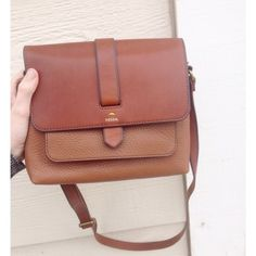 NEW Fossil Kinley Small Crossbody brown purse NEW Fossil Kinley Small Crossbody brown purse. Brand new!!! Leather  purse. Great for summer. 100% leather. Has 1 pocket on the back. Flap snaps closed. Flap opens up and there's another pocket on the exterior. Zipper opens and has a compartment with a side pocket and a media pocket on the inside. 9 inches in length. 3.25 inches wide, 7.25 inches in height. Strap strap left is about 21.5 inches and is adjustable. Brass hardware *not as large as…