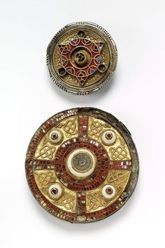 The Milton Jewel is one of the finest examples of Anglo-Saxon brooches of the period, with a sophisiticated design carried out in a combination of materials.The use of cloisons inlaid with garnet, filigree knot work decoration on gold sheet and shell bossess are typical of this type. The brooch was found in 1832 in a cemetery at Milton, west of Dorchester-on-Thames. Probably Kent, VIIc