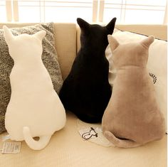 Cat Back Shadow Soft Plush. These kitties are mesmerized by the moon and the excitement the night brings. This pillow is sure to be the puuuurrfect headrest for a movie night on the couch.
