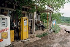 great old store with shell gas pumps