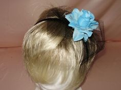 Lovely New Fascinator with Turquoise rose on a satin Headband ,Black Netting This lovely fascinator is available in my  Ebay  store  kringle3  Please see all my unique items in my store .