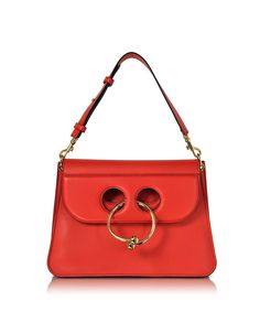 Scarlet Medium Pierce Bag crafted in natural grained calfskin, has a modern structure with a playful touch and a striking element. Featuring double flap with circular barbell piercing closure, single detachable and adjustable shoulder strap, three internal compartments, soft leather lining and gold tone hardware. Signature dust bag included.