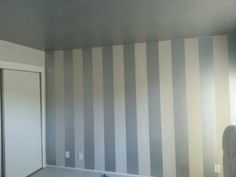 painted vertical striped wall- like the stripes! Makes the room look taller