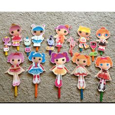 Step 1: Print out Lalaloopsy dolls from Internet. Step 2: Glue dolls to Construction Paper Step 3: Laminate.  Step 4: Attach to popsicle sticks.   Step 5: Watch 3 year old daughter play for hours.