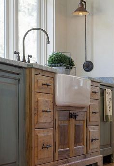 Farmhouse style kitchen cabinet design ideas (22) | Really like the stepped out, different color sink surround.