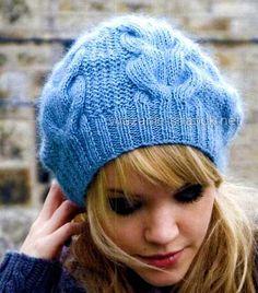 Зимняя шапочка спицами с косами 2