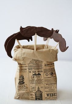 I like the printed bag. Maybe glue some newspaper (or printed scrapbook paper or printed off the computer) onto generic brown paper bags