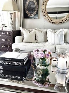This eclectic living room incorporates modern and vintage design elements. This is reflected on the coffee table with a selection of contemporary design books and a collection of more traditional glassware. The roses add texture and colour to the coffee table. - See more at: http://www.home-dzine.co.za/decor/decor-coffee-table-style.htm#sthash.X2Wh8F8S.dpuf