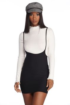722dcde5f8c3 You're intellectually known and your style reflects it! This black  suspender mini skirt