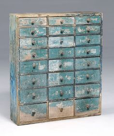 Blue painted apothecary- the graduated drawers and wear are just incredible.