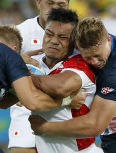 #RIO2016 British players try to stop Japan's Lomano Lemeki in the second half of a Pool C match in the men's rugby sevens tournament at the Rio de Janeiro...
