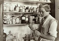 0131525 © Granger - Historical Picture ArchiveCHEMISTRY CLASS, 1921.   A high school student in the chemical laboratory at the Greenbank Consolidated School, Pocahontas County, West Virginia. Photograph by Lewis Hine, October 1921.