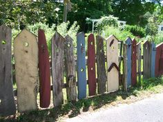 "whimsical ""birdhouse"" fence"