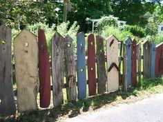 "whimsical ""birdhouse"" fence"