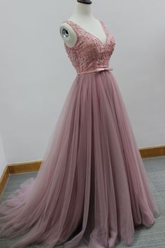 $199.00 *Fabric:tulle *Color: Picture Color or Option Color. *Size: standard size or custom size. *Sleeve:none *Back:lace up *Style:floor-length