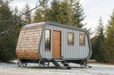 This distinctive cabin on cast-iron wheels looks like a cross between a camper and a traditional sheepherder's wagon.