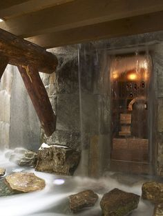 Indoor moat leading to an underground wine cellar with a waterfall for a door that stops flowing when you walk on the stepping stones! o.O