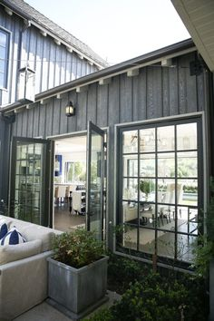 Bill Davidson, along with his A-team at R. Douglas Mansfield Architects, put the… Bill Davidson, along with his A-team at R. Douglas Mansfield Architects, put. Modern Farmhouse Interiors, Farmhouse Design, Farmhouse Style, Farmhouse Ideas, American Barn, American Farmhouse, Garage Door Design, Garage Doors, Diy Barn Door