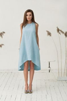 Hand crafted soft pure linen dress for women in light blue colour. Made from a middle weight linen fabric this contemporary dress is a must for this spring and summer. Breezy, breathable, relaxed fit - perfect in the office or at the beach. Please note that the model is 175 cm height. If