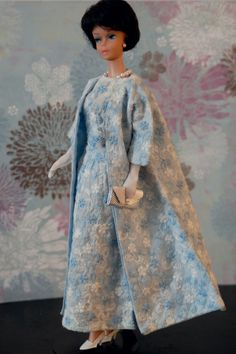 Barbie is wearing a lovely vintage gown with matching Opera coat