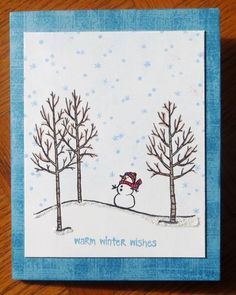 The sky is sponged with Bashful Blue.  The trees were coloured with pencil crayons.  A little bit of Stickles on the snowman's nose and hat and along the snowbank.