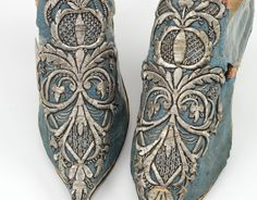 Detail embroidery, pair of ladies shoes, c. 1700. Blue silk damask with loral metallic thread embroidery; pointed toe, high louis heel.