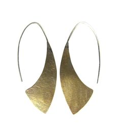 These earrings are hand-fabricated from brass and sterling silver and hang from 20 gauge sterling silver ear wires. The ear wires are hammered along the arch to enhance strength and to retain shape. E