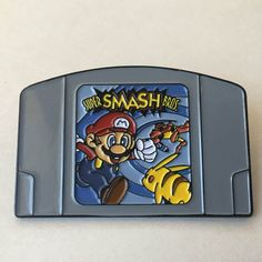 Super Smash Bros N64 Cartridge Enamel Pin by NostalgiaPinCo on Etsy https://www.etsy.com/listing/504638162/super-smash-bros-n64-cartridge-enamel