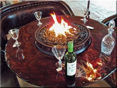 Wine Barrel Fire Pit with a Table installed. Wine Barrel Fire Pit, Wine Barrels, Diy Propane Fire Pit, Glass Fire Pit, Fire Pits, Barrel Projects, Glass Rocks, Backyard Projects, Outdoor Projects