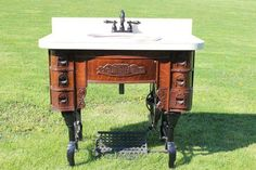 Restored bathroom sink. Made from an old Singer sewing machine table. #DIY