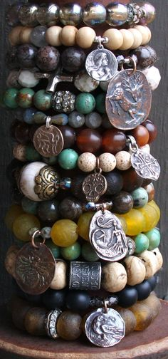 Gorgeous gemstone bracelets with cool vintage looking coin charms!