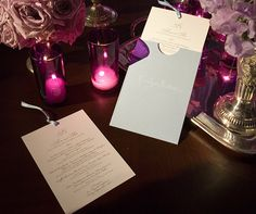 Guests' names are written on light blue envelopes, which contain the dinner menu.