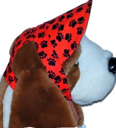 Mini Black Paw Prints, scattered on a Red background, make this Visor a fun fashion look for your Dog to wear to the beach or a stroll at the Park, or perhaps a backyard picnic.  The fabric is 100% Cotton, with the Visor having an inner core of interfacing to keep its shape.  It features openings for the Dog's ears and closes under the chin with hook and loop tape, for easy on and off and size adjustments. #dogs #sunvisor