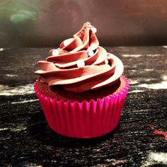 Chocolate cupcakes with homemade raspberry coulis filling, topped with chocolate cream cheese frosting