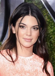 Kendall Jenner incorporated peach tones from her eyes to her cheeks to her lips