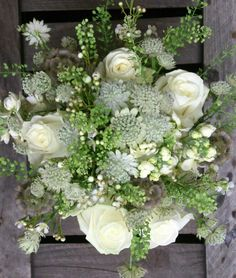 White wedding bouquet astrantia, roses, thalspi bell, stocks and scabious pods