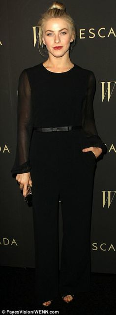 Now that's how to work a red carpet: Julianne Hough looked stunning in a black jumpsuit with sheer sleeves and lots of red lipsticks at an e...