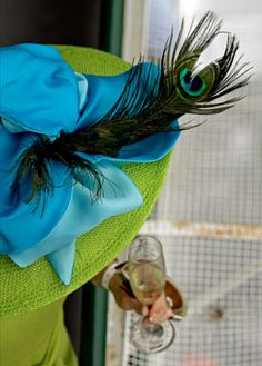 A spectator drinks champagne before the Kentucky Derby horse race at Churchill Downs Saturday, May in Louisville, Ky. (AP Photo/Charlie Riedel) Photo: Charlie Riedel, STF / BE Derby Time, Derby Day, Derby Horse Race, Horse Racing, Race Horses, Dresses For The Races, Run For The Roses, Feather Fashion, Parasols