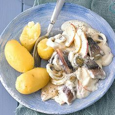 A very commom dish in Germany. It's a pickled herring in cream sauce with onions and pickle and apples. Always with steamed potatoes