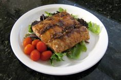 This is a recipe for salmon fillets with pecans and brown sugar glaze, a nice dish for a special occasion or weekend meal. The salmon is baked to perfection with the tasty glaze, bourbon optional.