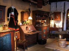 A museum display of what an old Norwegian house looked like inside. The bunad hanging on the wall is from Setesdal.
